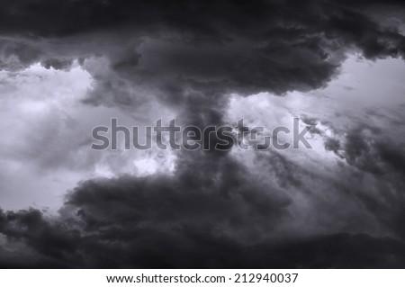 Dark ominous grey storm clouds. Dramatic sky.                        - stock photo