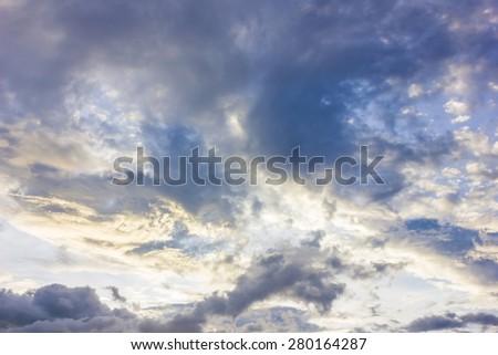 dark skies and bright sun. - stock photo