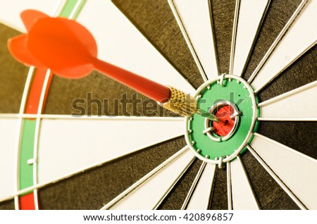dart in bull's eye close up - stock photo