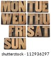 7 days of week (first 3 letter symbols) in isolated vintage wood letterpress printing blocks - stock photo
