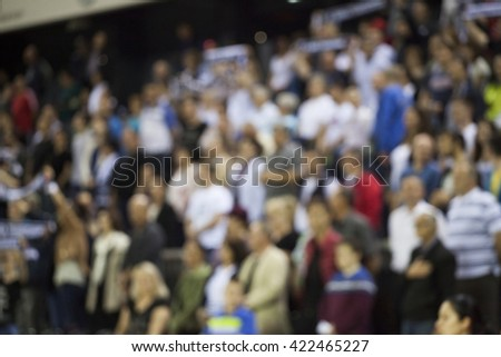 Defocused background of crowd of people at the basketball game - stock photo
