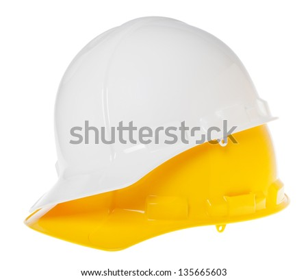 45 degrees view of two hard hats, yellow on top of white, isolated on white background. - stock photo