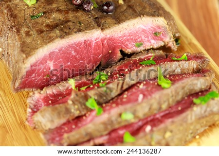 Delicious dinner of rare roast beef with cilantro - stock photo