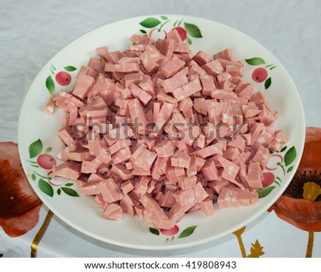 delicious  sliced Sausage on a white plate - stock photo