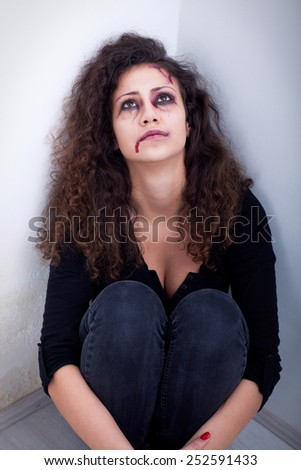 desperate scared and battered women,concept of violence over women - stock photo