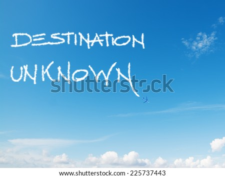 """destination unknown"" written in the sky with contrails left by airplane - stock photo"