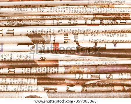 Detail of a pile of international newspapers vintage - stock photo