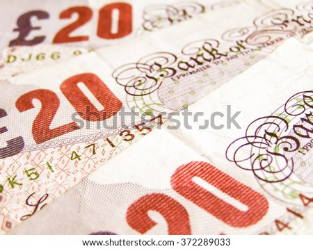 Detail of British Pound coins banknotes money vintage - stock photo
