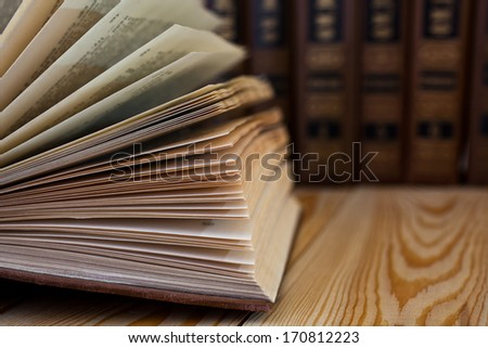 Detail of open book on the table - stock photo