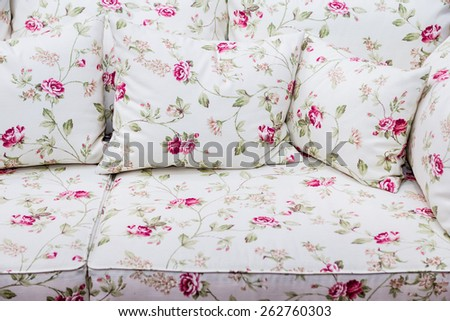 Detail of sofa with rose floral vintage ornament - stock photo