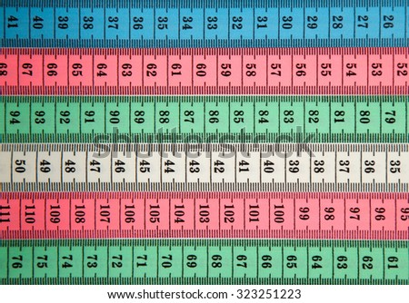 Different colors of Tailor measuring tapes - stock photo
