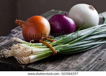 different onions on wood - stock photo