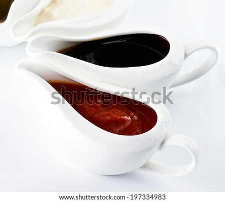 different sauces in a white bowls - stock photo