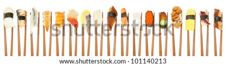 17 different types of sushi being held up in a row with wooden chopsticks isolated on white. - stock photo