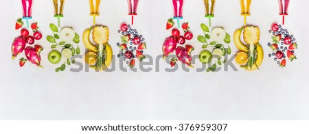 Diverse healthy fruits smoothies with colorful ingredients  on white wooden background, top view, banner. Superfoods and healthy lifestyle or detox  diet food concept. - stock photo