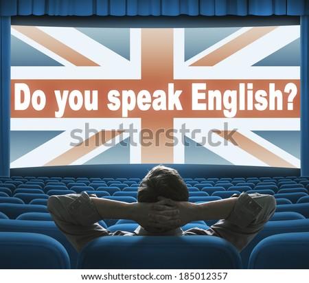 """Do you speak English?"" phrase on wide cinema screen - stock photo"