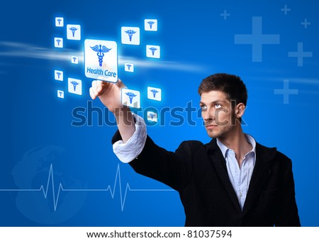 doctor pressing digital button ( Health Care ) - stock photo