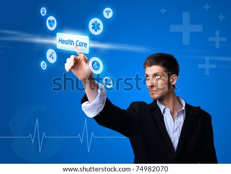 doctor pressing digital button ( medical assitance ) - stock photo