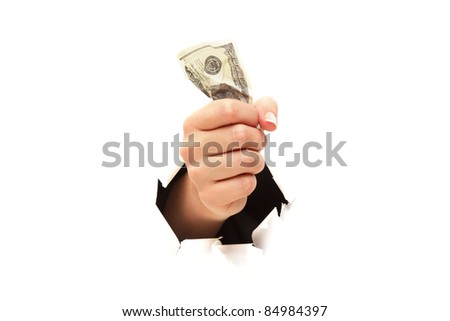 100 dollar bill in fist through paper hole isolated - stock photo