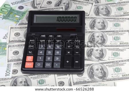 100 dollar, euro banknote and calculator - stock photo