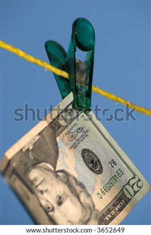 20 dollars bil is hanging on the clothline. - stock photo