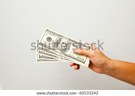500 dollars in a women hand. - stock photo