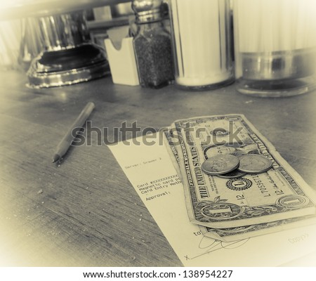 Don't forget to tip!  Art photo - intentional grain and noise with yellow tonality and vignette. - stock photo