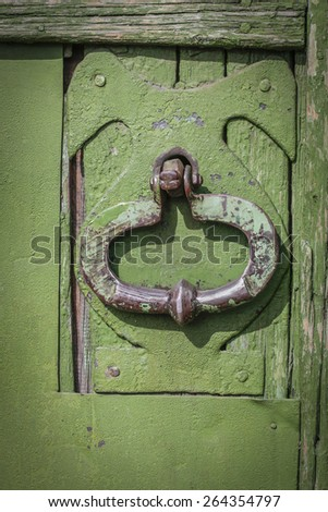 door knocker on an antique wooden door - stock photo