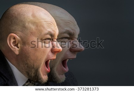 Double Exposure photo. Portrait of an adult man in a business suit on a black background. Side profile portrait of angry man screaming  - stock photo