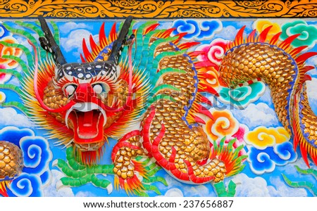 Dragon statue on the wall in Chinese Shrine. - stock photo