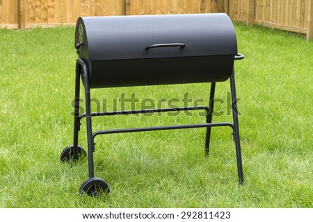 Drum Barrel Charcoal BBQ - Oil barrel style barbecue in garden - stock photo