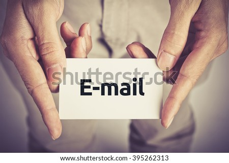 """ E-mail "" word on card hold by man - stock photo"