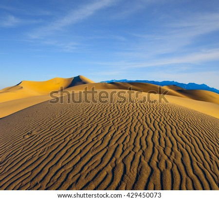 Early morning, sunrise in Death Valley, California. Magnificent sandy waves on dunes - stock photo