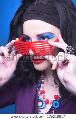 80-ears style. Young woman with bright visage in vintage style - stock photo