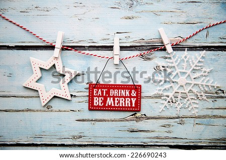 """""""Eat, drink and be merry"""" sign against a distressed wooden background - stock photo"""