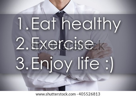 1.� Eat healthy 2.�Exercise 3.�Enjoy life :) - Closeup of a young businessman with text - business concept - horizontal image - stock photo