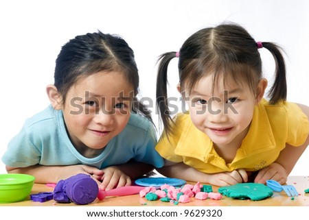 Education, learning, teaching. Playing with play doh. - stock photo