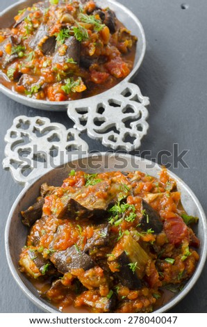Eggplant, bell pepper and tomato salad.  - stock photo