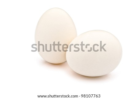 2 eggs with clipping path, one stands up the other lay down - stock photo