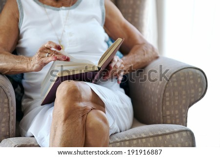 elderly woman reading her book hands anonymous - stock photo