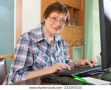 Elderly woman  studying computer literacy - stock photo