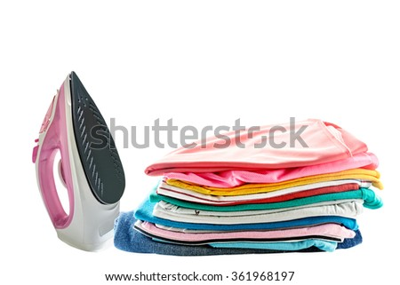 electric steam iron and Pile of colorful clothes isolated on white background - stock photo