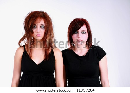 2 emo girls with messy hair and makeup - stock photo
