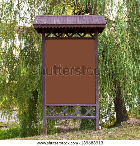 empty billboard in front of green trees - stock photo