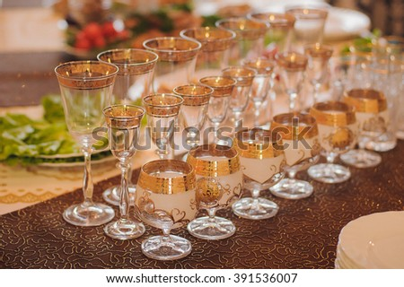Empty glasses on the table. Glasses for refreshments. - stock photo