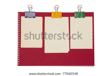 Empty photo on red notepad with binderclip. Isolated on white background \ Empty photo on red notepad - stock photo