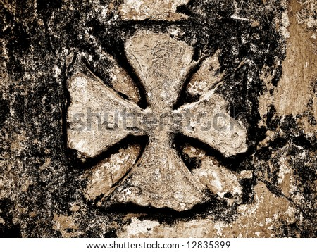 engraved cross in a church stone wall - stock photo