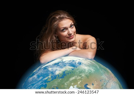 Environmental, eco concept. Closeup portrait of young female leaning on 3D rendered Earth globe over black background - stock photo