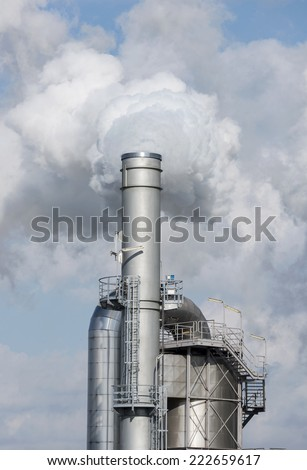 Environmental pollution and global warming by smoking chimney - stock photo