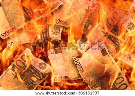 100 euro banknotes burning in flames - stock photo